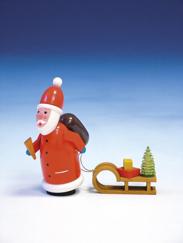Weihnachtsfigur Weihnachtsmann mit Eisenbahn bunt Länge 11 cm NEU