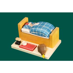 Räuchermann Weihnachtsmann im Bett klein geschnitzt