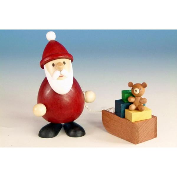 Weihnachtsfigur Weihnachtsmann mit Schlitten farbig , modern 9,3cm und 5,1 cm hoch NEU