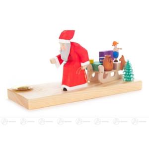 Schnitzerei Weihnachtsmann mit Schlitten, geschnitzt, für Kerze d=14mm Breite x Höhe x Tiefe 17 cmx9 cmx15,5 cm NEU